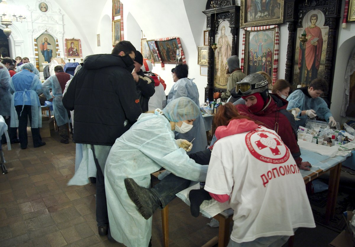 by-the-end-of-tuesday-night-citizens-set-up-a-makeshift-hospital-in-st-michaels-golden-domed-cathedral